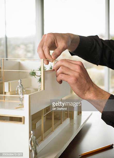 Architect working on scale model