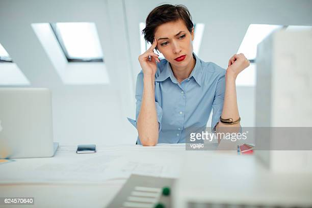 Architect Working Under Pressure In Her Office.