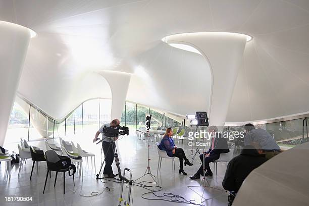 Architect Zaha Hadid is interviewed by Jeremy Paxman in the new extension to the redeveloped Serpentine Sackler Gallery in Hyde Park on September 25...