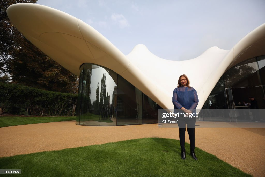 Architect <a gi-track='captionPersonalityLinkClicked' href=/galleries/search?phrase=Zaha+Hadid&family=editorial&specificpeople=560782 ng-click='$event.stopPropagation()'>Zaha Hadid</a> poses for a photograph in front of the redeveloped Serpentine Sackler Gallery in Hyde Park on September 25 2013 in London, England. The renovation of the 1805 gunpowder store, located on the north side of the Serpentine Bridge, was designed by <a gi-track='captionPersonalityLinkClicked' href=/galleries/search?phrase=Zaha+Hadid&family=editorial&specificpeople=560782 ng-click='$event.stopPropagation()'>Zaha Hadid</a> Architects. The new gallery, restaurant and social space will officially open to the public on September 28, 2013.