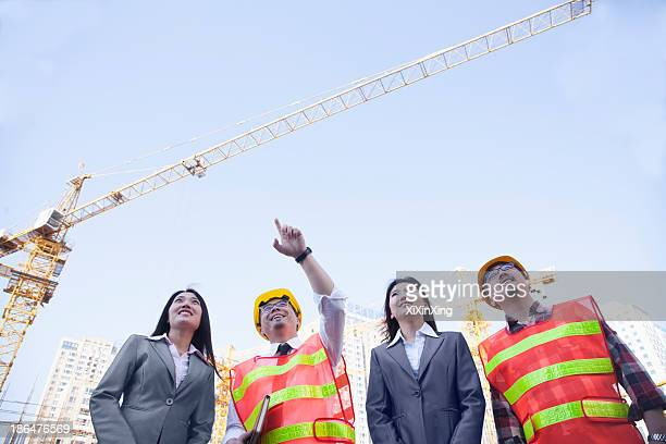 Architects and businesswomen at a construction site, Beijing