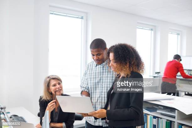 Architects and project managers working in office