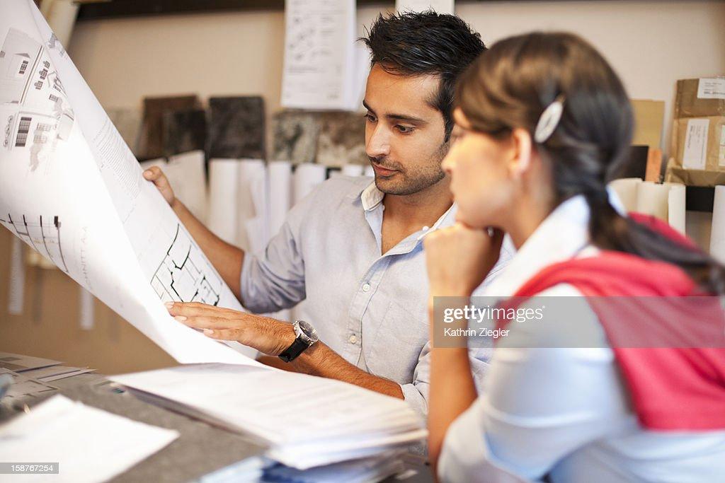 architects examining plans together : Stock Photo