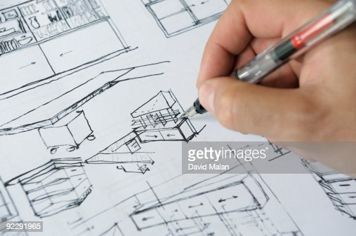 Architects hand sketching interior plans : Stock Photo