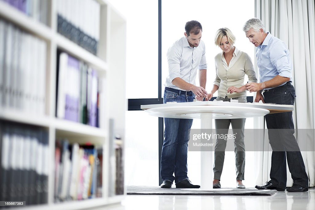 Architects looking at a model : Stock Photo