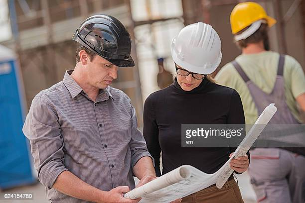 Architects looking at construction plans