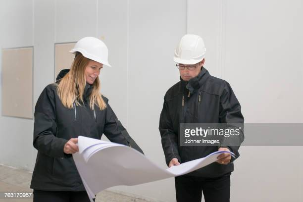 Architects looking at plans