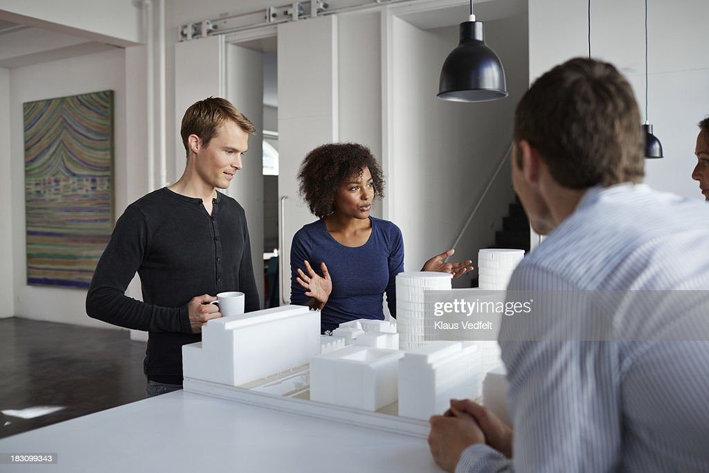 Architects presenting new project in foam : Stock Photo