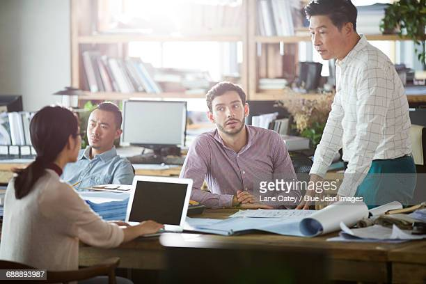 Architects talking in the office