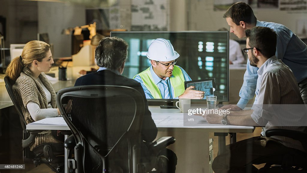 Architects team having video conference : Stock Photo