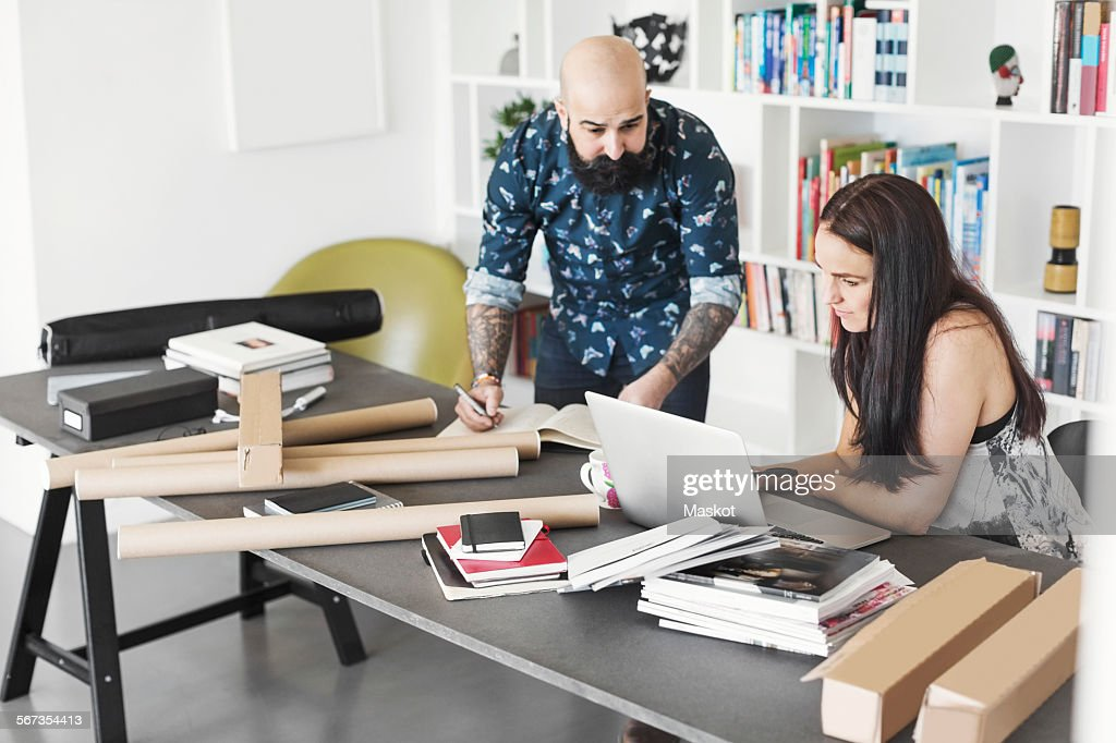 Architects using laptop at home office