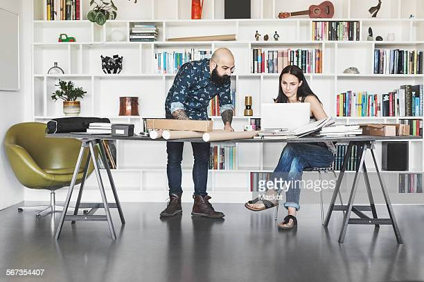 Architects working at table in home office