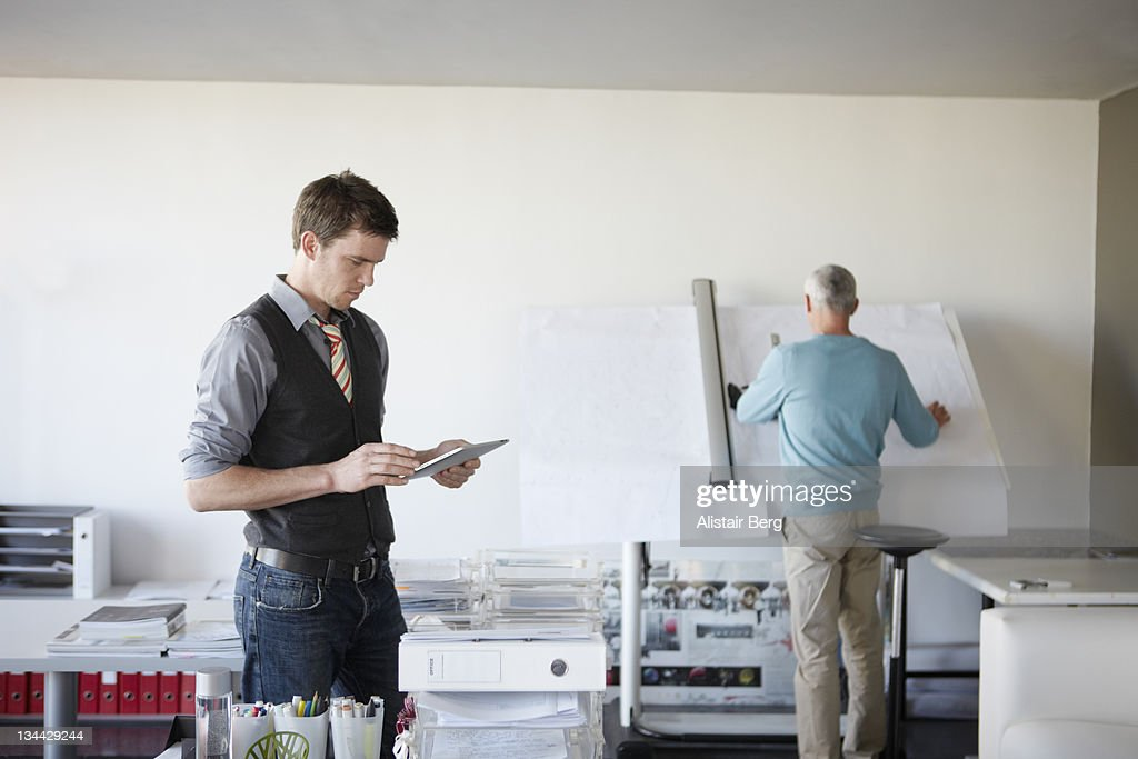 Architects working in a modern office : Stock Photo