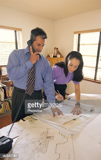 Architects working in home office : Stock Photo