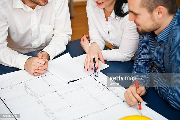 Architects working on a blueprint