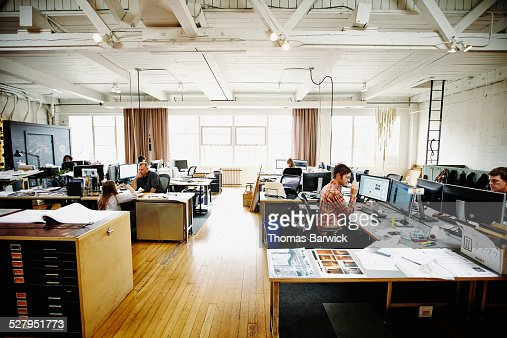 Architects working on design projects in office