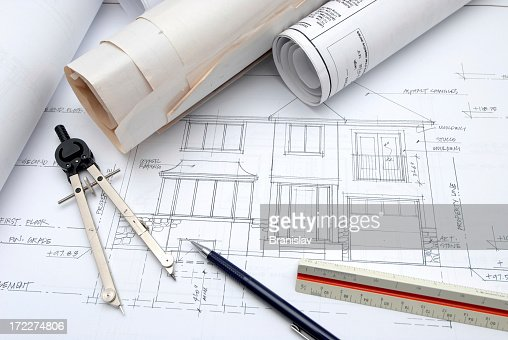 Architectural Design Tools And Blueprints On A Desk Stock Photo