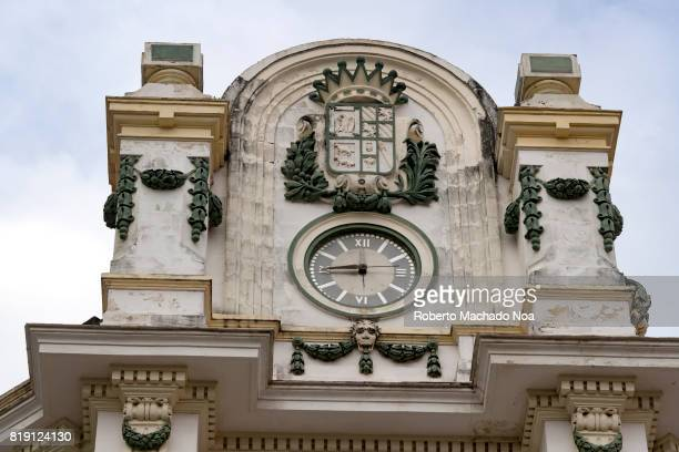 Architectural detail in Old Havana An old clock is part of a decorative structure