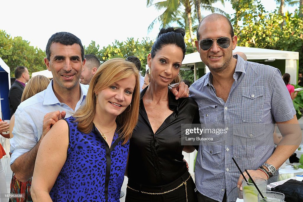 Architectural Digest's Giulio Capua and Susan Keena with Maggie Amir of Caesarstone and Bill Pittel at AD Oasis hosts Caesarstone's Happy Hour at The Raleigh on December 7, 2012 in Miami, Florida.