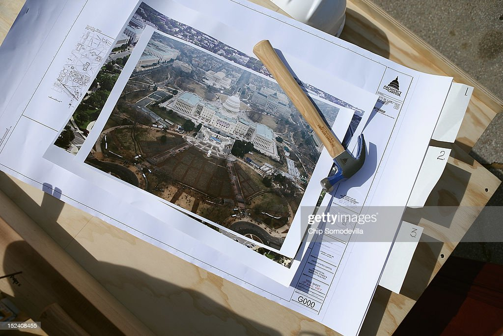 Architectural drawings of the 2013 Inaugural Platform are on display during the 'First Nail' ceremony, signifying the start of construction of the platform on the West Front of the U.S. Capitol September 20, 2012 in Washington, DC. The winner of the November 6 presidential election will be sworn in on the platform on January 21, 2013.
