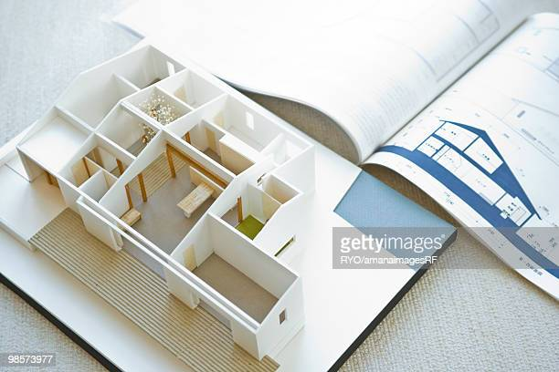 Architectural model with blueprint