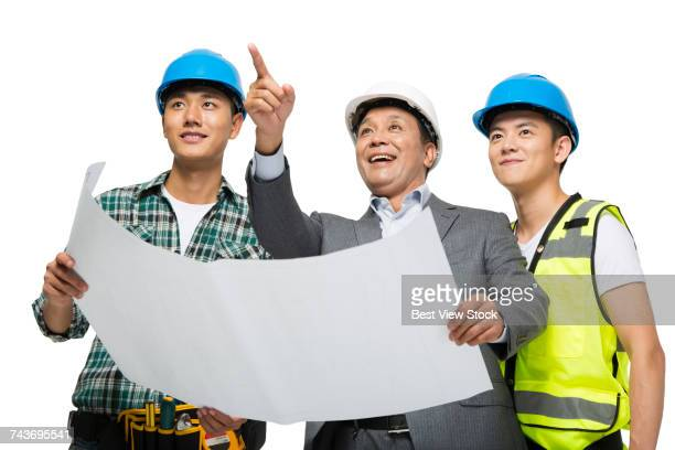 Architectural team holding a drawing