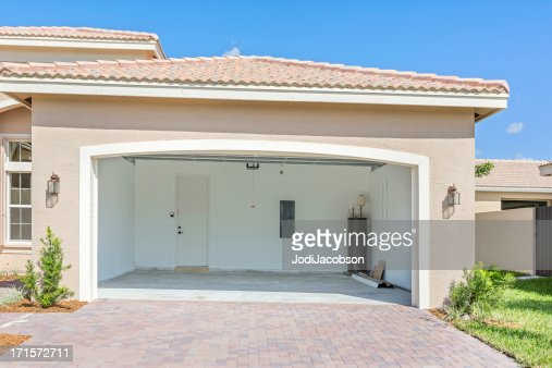 Architecture: Brand new house  being built with an empty garage