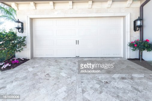 Architecture: Brand new house with a garage : Stock Photo