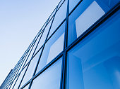 Architecture detail Modern Glass facade Background Blue tone