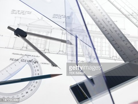 Drawing Equipment Sitting On Engineering Drawing Stock Photo