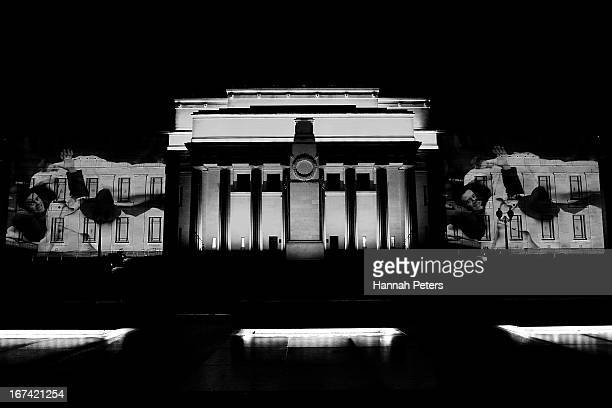 Archive footage is projected onto the walls of the Auckland Museum prior to ANZAC Day on April 23 2013 in Auckland New Zealand Veterans dignitaries...
