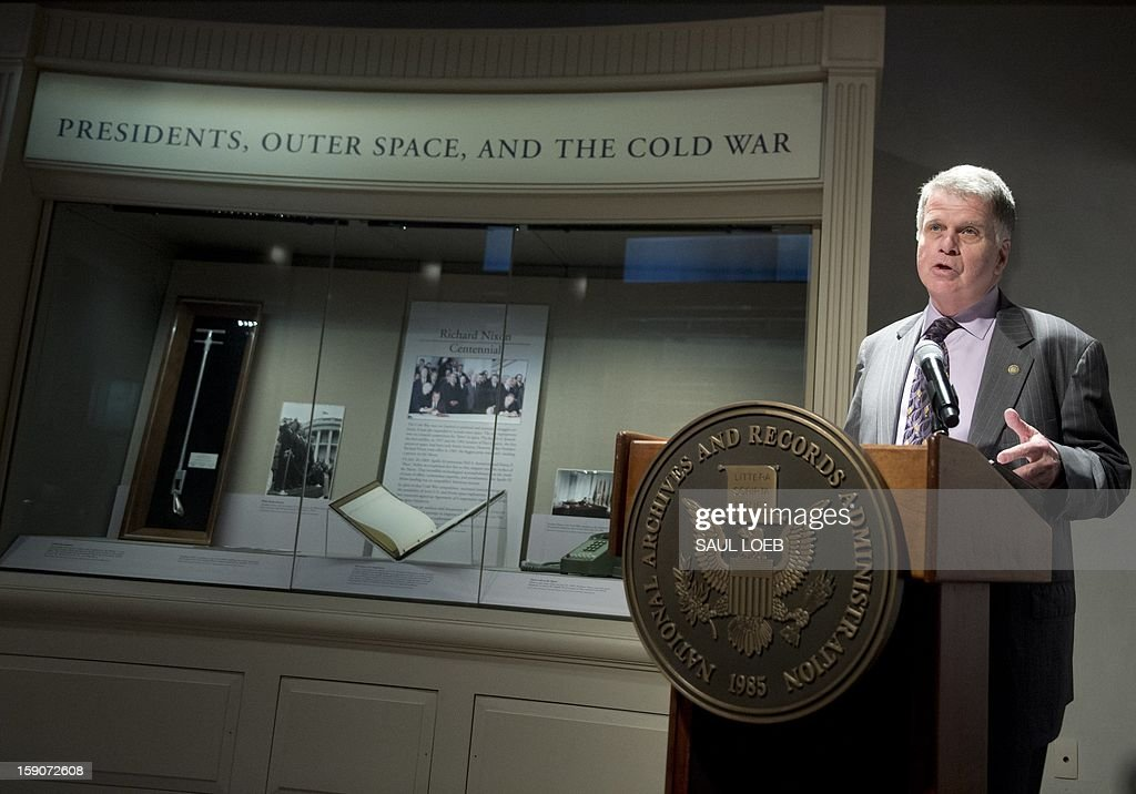 Archivist of the United States David Ferriero speaks during the opening of a new exhibit featuring objects from the US Presidency of Richard Nixon and related to the US Space program at the National Archives in Washington on January 7, 2013. The exhibit, 'Nixon and the US Space Program,' features rarely seen documents, photographs and objects representating milestones in manned spaceflight from the Nixon administration, including the telephone used by Nixon to talk with Apollo 11 astronauts after the moon landing, tongs used by Apollo 12 astronauts to collect moon rock samples and a contingency speech drafted in case of disaster during the 1969 Apollo 11 lunar landing mission. AFP PHOTO/Saul LOEB