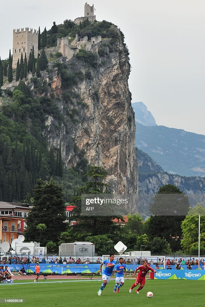 Arco Castle can be seen in the background during the friendly football match between FC Bayern Munich and Napoli at Municipal Stadium in Arco near...