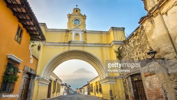 Arco de Santa Catalina (Santa Catalina Arch) and Volcan de Agua in Antigua Guatemala