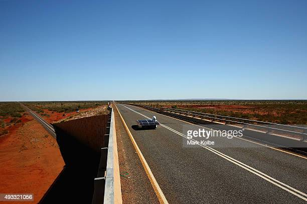 Arctan of Stanford Solar Car Project USA cross the Ghan overpass as it races in the Challenger Class during day two of the 2015 World Solar Challenge...
