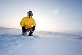 Arctic Fog.  Man in a Parka on the Snow