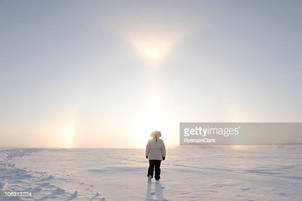 Arctic Sundogs or Parhelion with Woman in parka.
