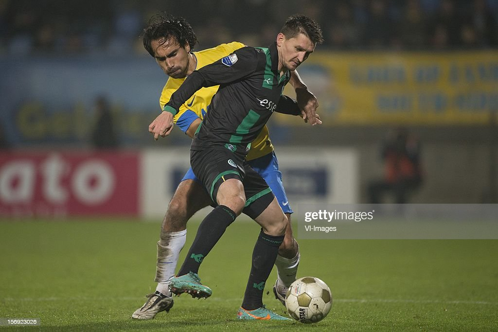 Ard van Peppen of RKC Waalwijk, Andraz Kirm of FC Groningen during the Dutch Eredivisie match between RKC Waalwijk and FC Groningen at the Mandemakers Stadium on November 24, 2012 in Waalwijk, The Netherlands.