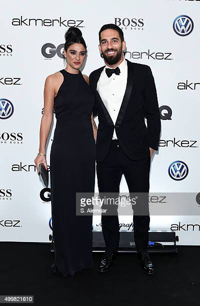 Arda Turan and a guest attend the GQ Men of the Year Awards at Four Season Bosphorus Hotel on December 3 2015 in Istanbul Turkey