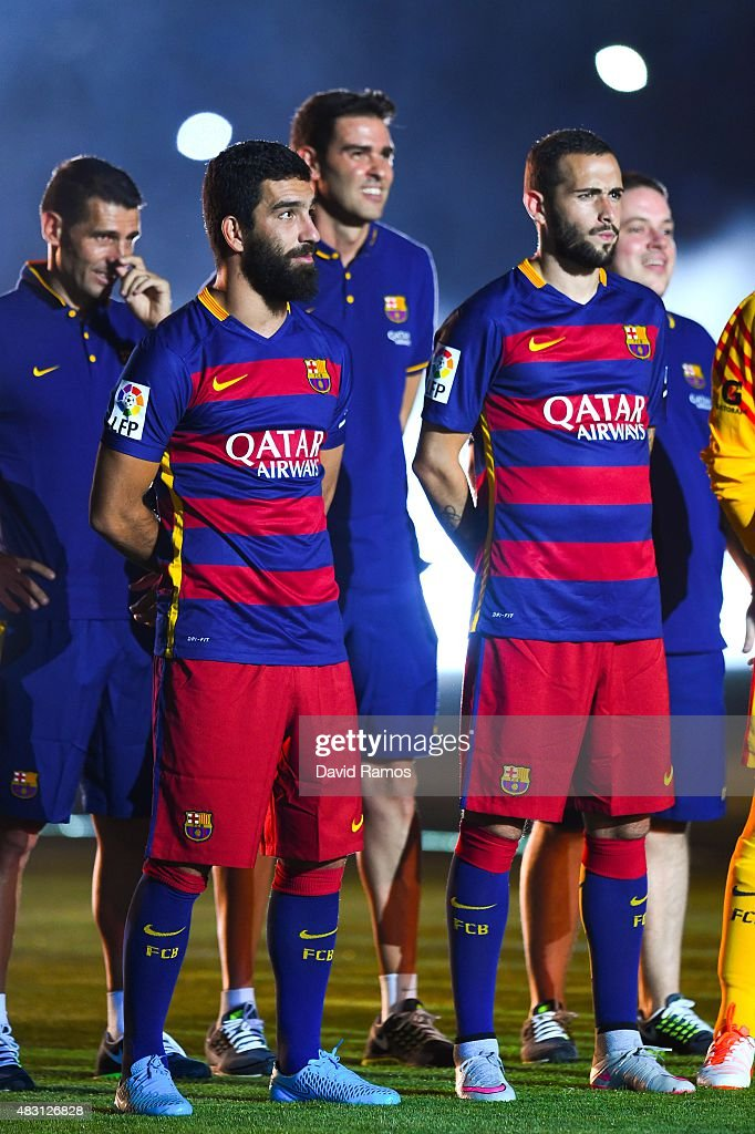 <a gi-track='captionPersonalityLinkClicked' href=/galleries/search?phrase=Arda+Turan&family=editorial&specificpeople=2179402 ng-click='$event.stopPropagation()'>Arda Turan</a> (L) and Aleix Vidal of FC Barcelona look on during the team official presentation ahead of the Joan Gamper trophy match at Camp Nou on August 5, 2015 in Barcelona, Spain.