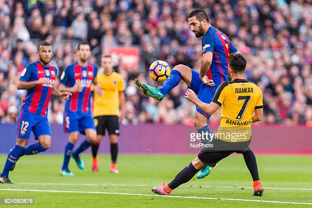 Arda Turan and Juankar during the match between FC Barcelona vs Malaga CF for the round 12 of the Liga Santander played at Camp Nou Stadium on 19th...