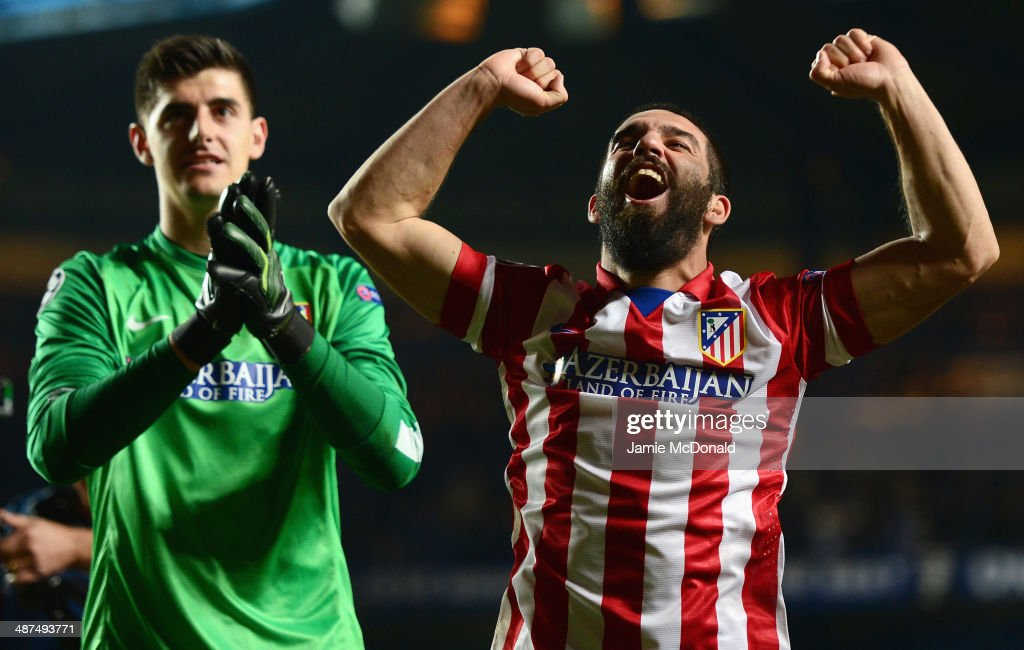 Arda Turan (R) and Thibaut Courtois of Club Atletico de Madrid celebrate victory after the UEFA Champions League semi-final second leg match between Chelsea and Club Atletico de Madrid at Stamford Bridge on April 30, 2014 in London, England.