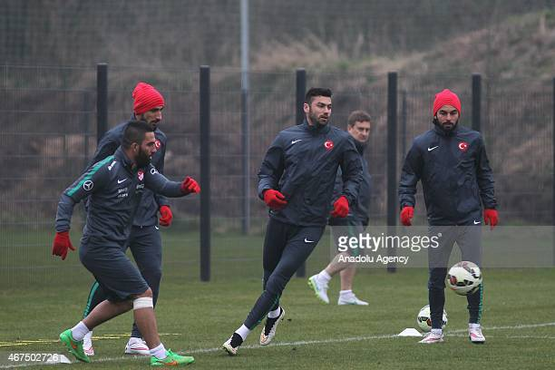 Arda Turan Burak Yilmaz and Selcuk Inan of Turkey exercise during the training session ahead of UEFA Euro 2016 qualifying match between Turkey and...