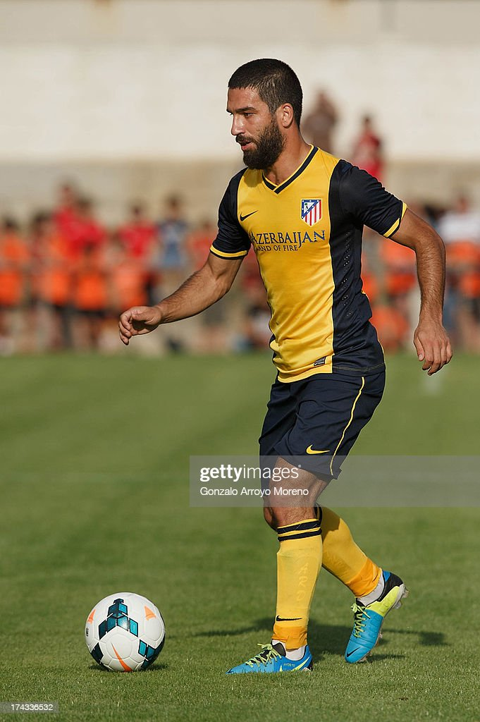 <a gi-track='captionPersonalityLinkClicked' href=/galleries/search?phrase=Arda+Turan&family=editorial&specificpeople=2179402 ng-click='$event.stopPropagation()'>Arda Turan</a> of Atletico de Madrid controls the ball during the Jesus Gil y Gil Trophy between Club Atletico de Madrid and Numancia C. D. at Sporting Club Uxama on July 21, 2013 in Burgo de Osma, Soria, Spain.