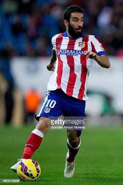Arda Turan of Atletico de Madrid controls the ball during the La Liga match between Club Atletico de Madrid and Villarreal CF at Vicente Calderon...