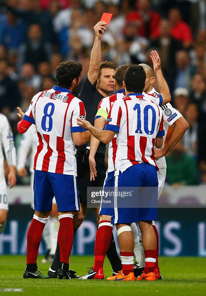 <a gi-track='captionPersonalityLinkClicked' href=/galleries/search?phrase=Arda+Turan&family=editorial&specificpeople=2179402 ng-click='$event.stopPropagation()'>Arda Turan</a> of Atletico Madrid (10) is sent off by referee <a gi-track='captionPersonalityLinkClicked' href=/galleries/search?phrase=Felix+Brych&family=editorial&specificpeople=707645 ng-click='$event.stopPropagation()'>Felix Brych</a> during the UEFA Champions League quarter-final second leg match between Real Madrid CF and Club Atletico de Madrid at Bernabeu on April 22, 2015 in Madrid, Spain.