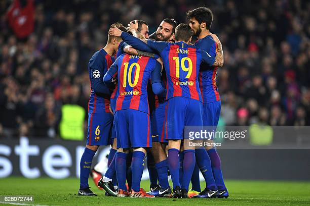 Arda Turan of Barcelona celebrates with team mates as he scores their third goal during the UEFA Champions League Group C match between FC Barcelona...