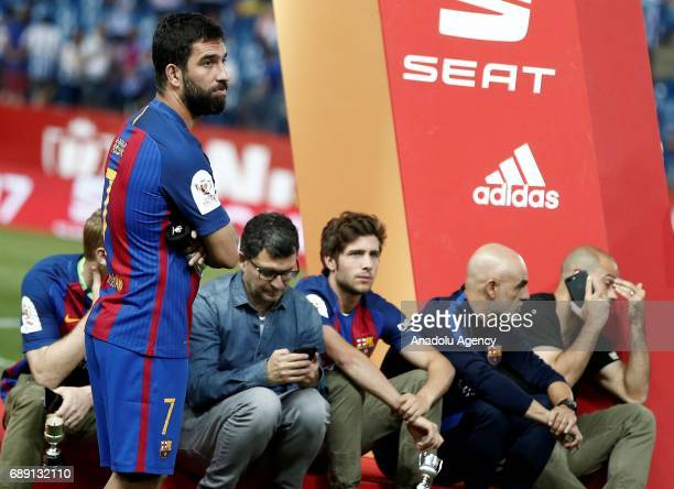 Arda Turan of Barcelona gestures after the Copa Del Rey Final between FC Barcelona and Deportivo Alaves at Vicente Calderon Stadium on May 27 2017 in...