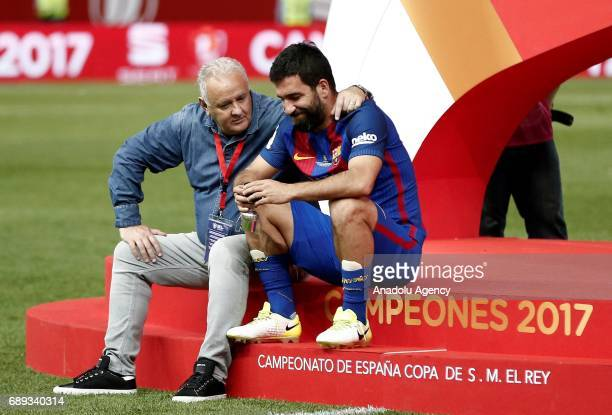 Arda Turan of Barcelona sits on the stage after the Copa Del Rey Final between FC Barcelona and Deportivo Alaves at Vicente Calderon Stadium on May...