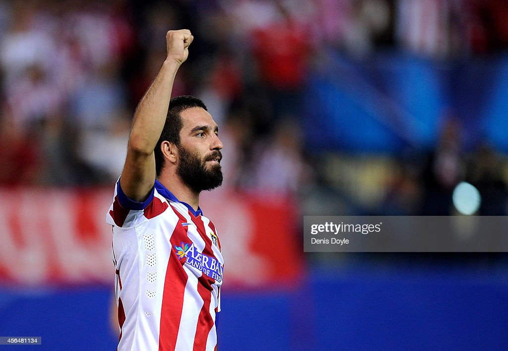 <a gi-track='captionPersonalityLinkClicked' href=/galleries/search?phrase=Arda+Turan&family=editorial&specificpeople=2179402 ng-click='$event.stopPropagation()'>Arda Turan</a> of Club Atletico de Madrid celebrates after scoring his team's opening goal during the UEFA Champions League Group A match between Club Atletico de Madrid and Juventus at Vicente Calderon Stadium on October 1, 2014 in Madrid, Spain.